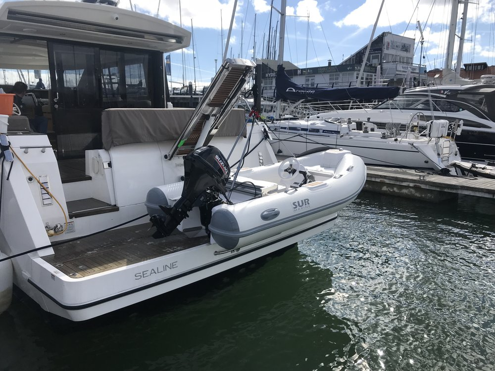 Just the Tonic   After visiting the SUR Marine stand at London Boat show the new owners of (Just the Tonic) Sealine Sc48 wanted a small lightweight tender. the 290 Sur with a 20hp was the boat of choice. See photos of her fit. Feb 2018
