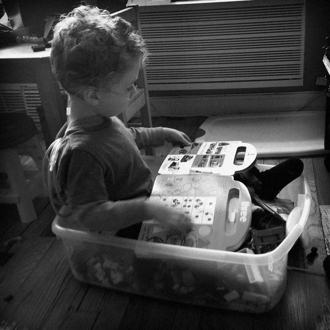 Reading in a toy box.