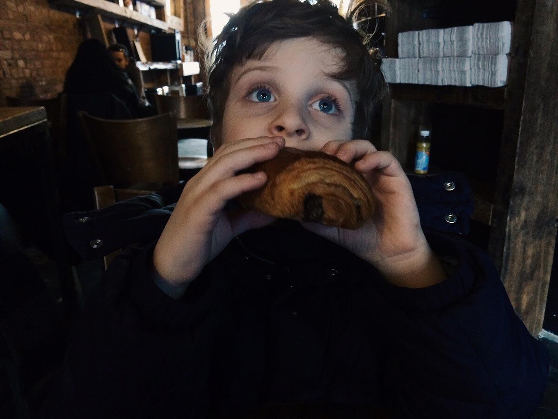 C eats a croissant