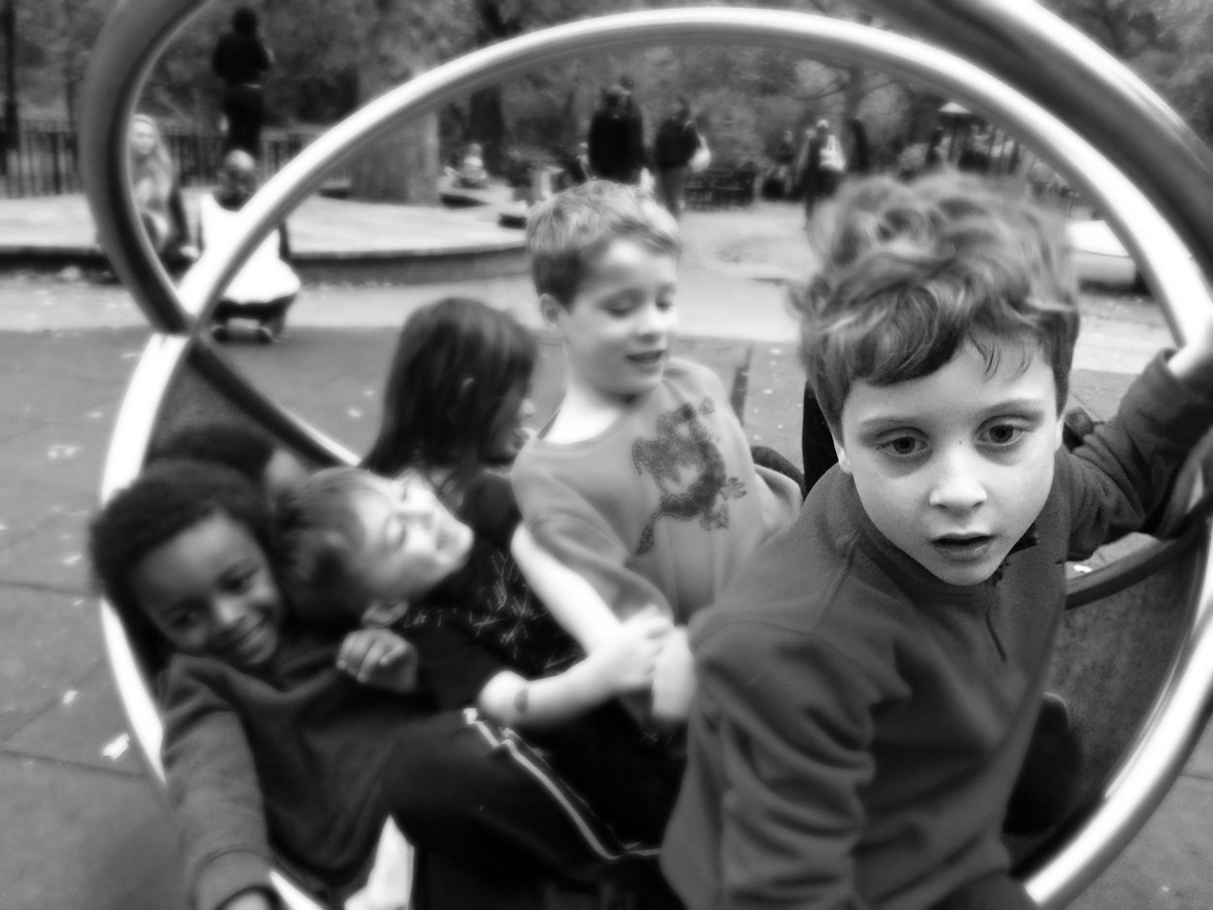 C in a playground with other children