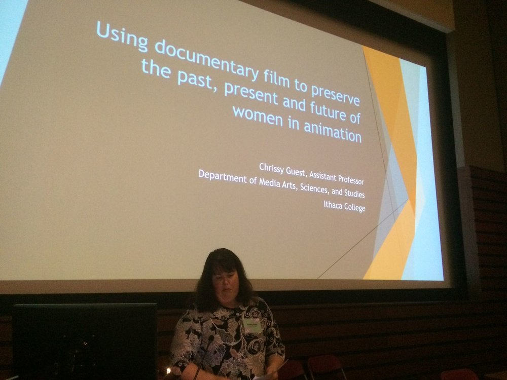 Fig. 3 - Dr Chrissy Guest (Ithaca College) provides the audience with a glimpse into her findings drawn from her    Beyond Ink & Paint: The Women of Animation documentary film.