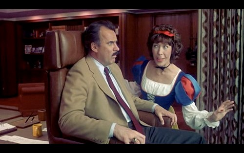 Fig. 7 - Tomlin as Violet as Snow White in  9 to 5 .