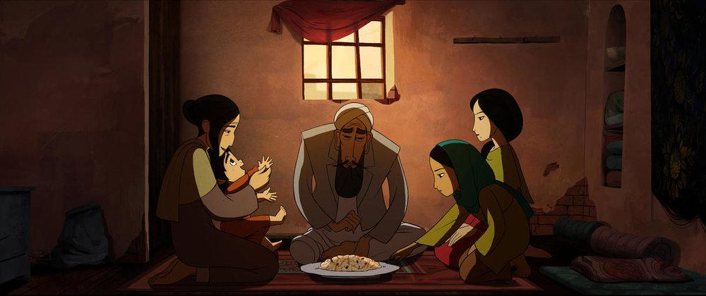 Fig. 2 - A family dinner in  The Breadwinner.