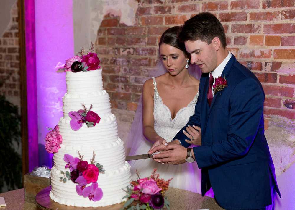 wedding cake with bright purple and pinks.jpg