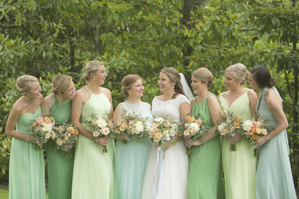 Sarah's wedding is proof that a variety of green bridesmaid dresses can look AMAZING! She wanted some corals and blush tones to pop alongside her greens, and it all pulled together perfectly!