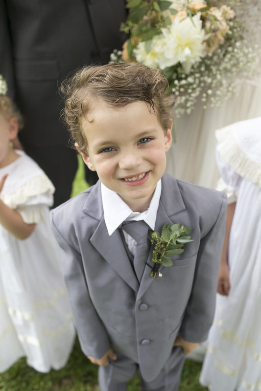 green boutonniere for ring bearer.jpg