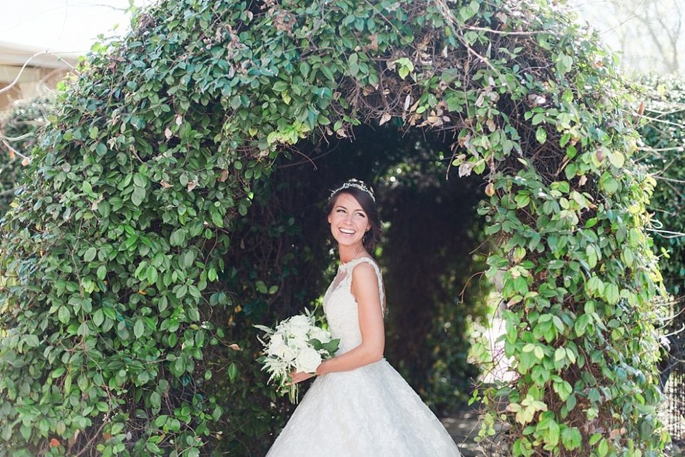 bride pictures with leafy arch.jpg