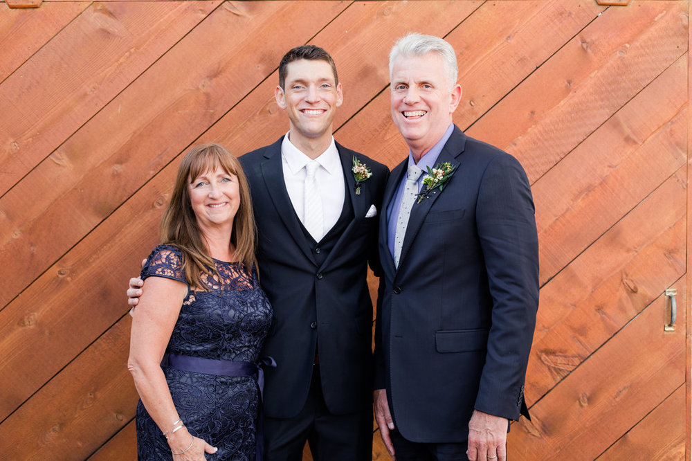 groom with parents picture.jpg