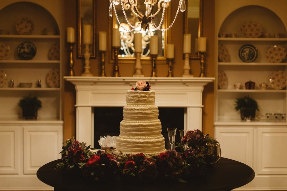 simple wedding cake with floral on top.jpg