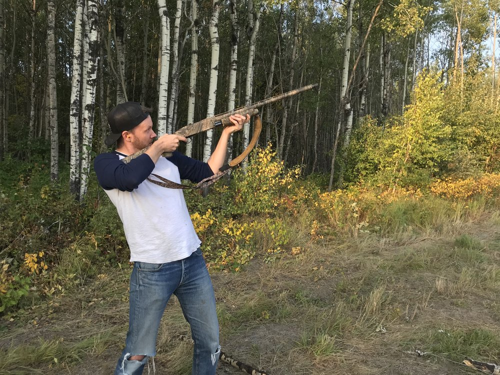 Perhaps it's just me, but I think Jer looks a wee bit TOO comfortable with this rifle in his hand…