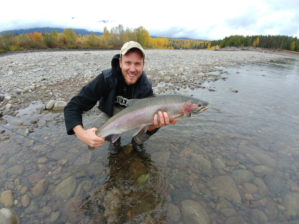 John caught it…and let Jer reel it in. What a host! And what a gorgeous steelhead! Jer, you look good, too, hon…
