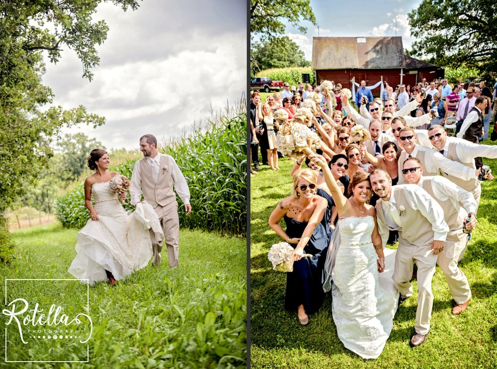 Bride and Groom in green field and with wedding party