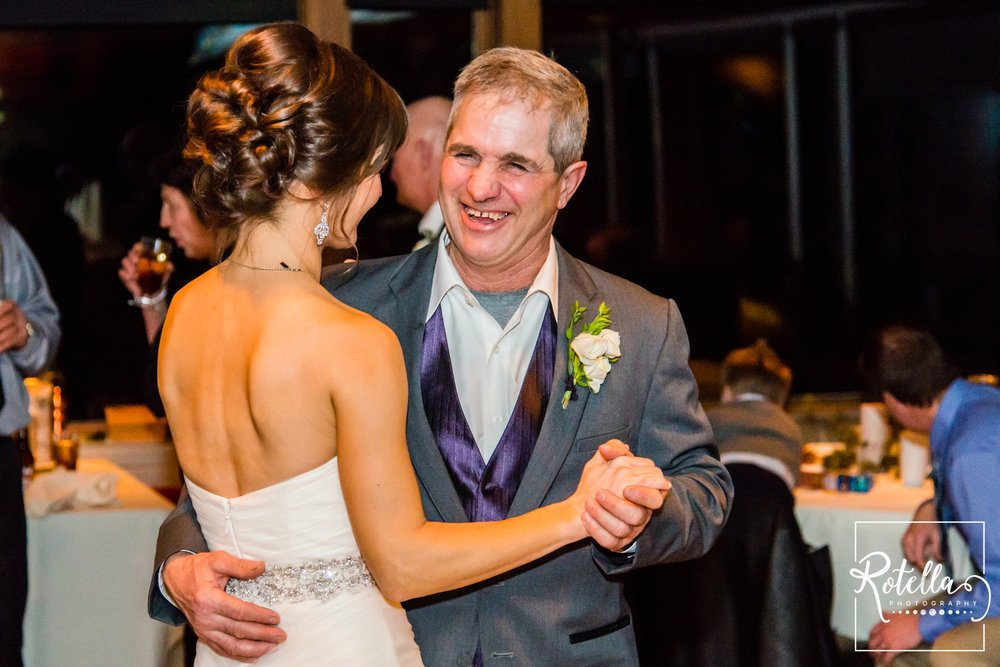 Father of bride smiling while dancing with daughter - Rotella Photography