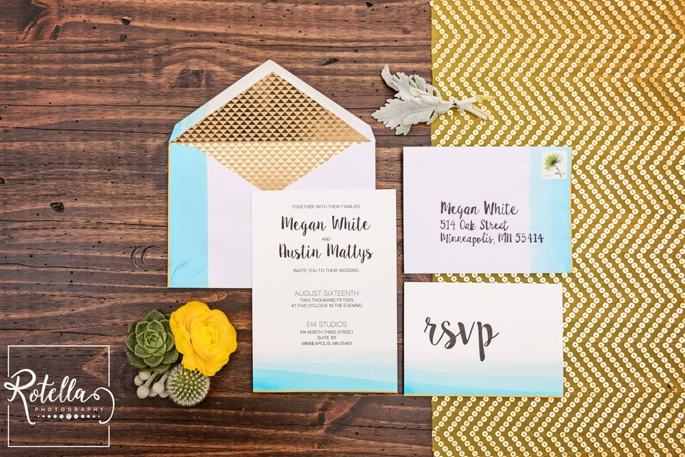 Dip-dyed teal and gold hand-made wedding invitation suite