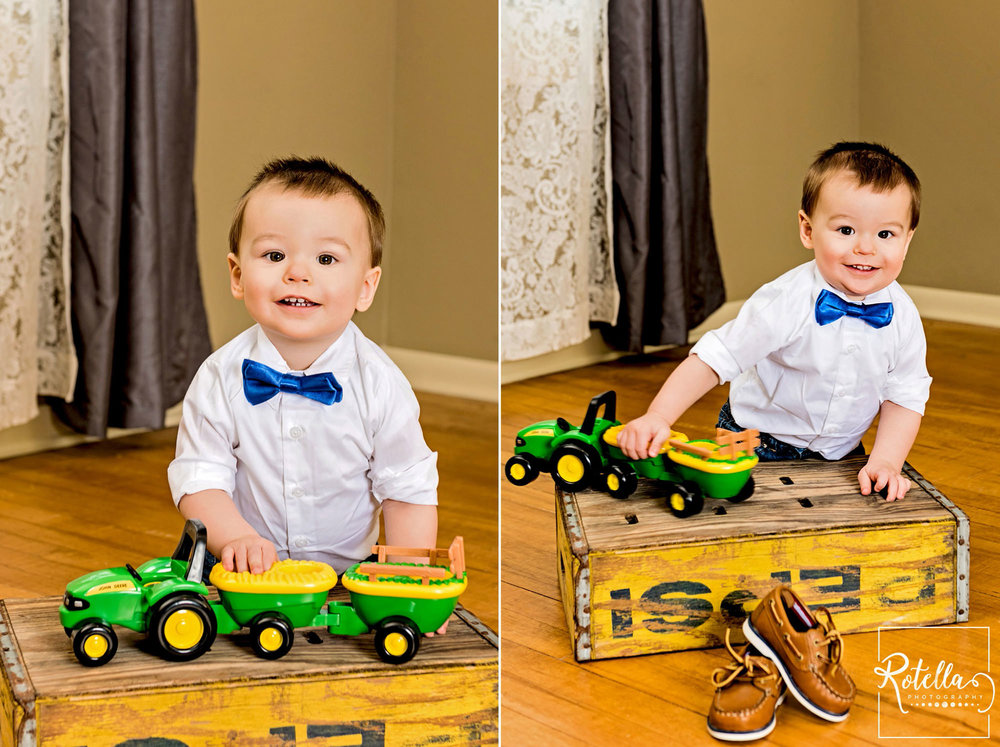 Rotella Photography - family photography baby playing with tractor in studio