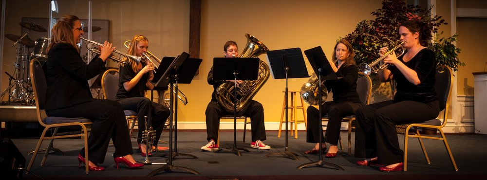 That's Faithe on the far left, performing with the Brass Belles brass quintet.