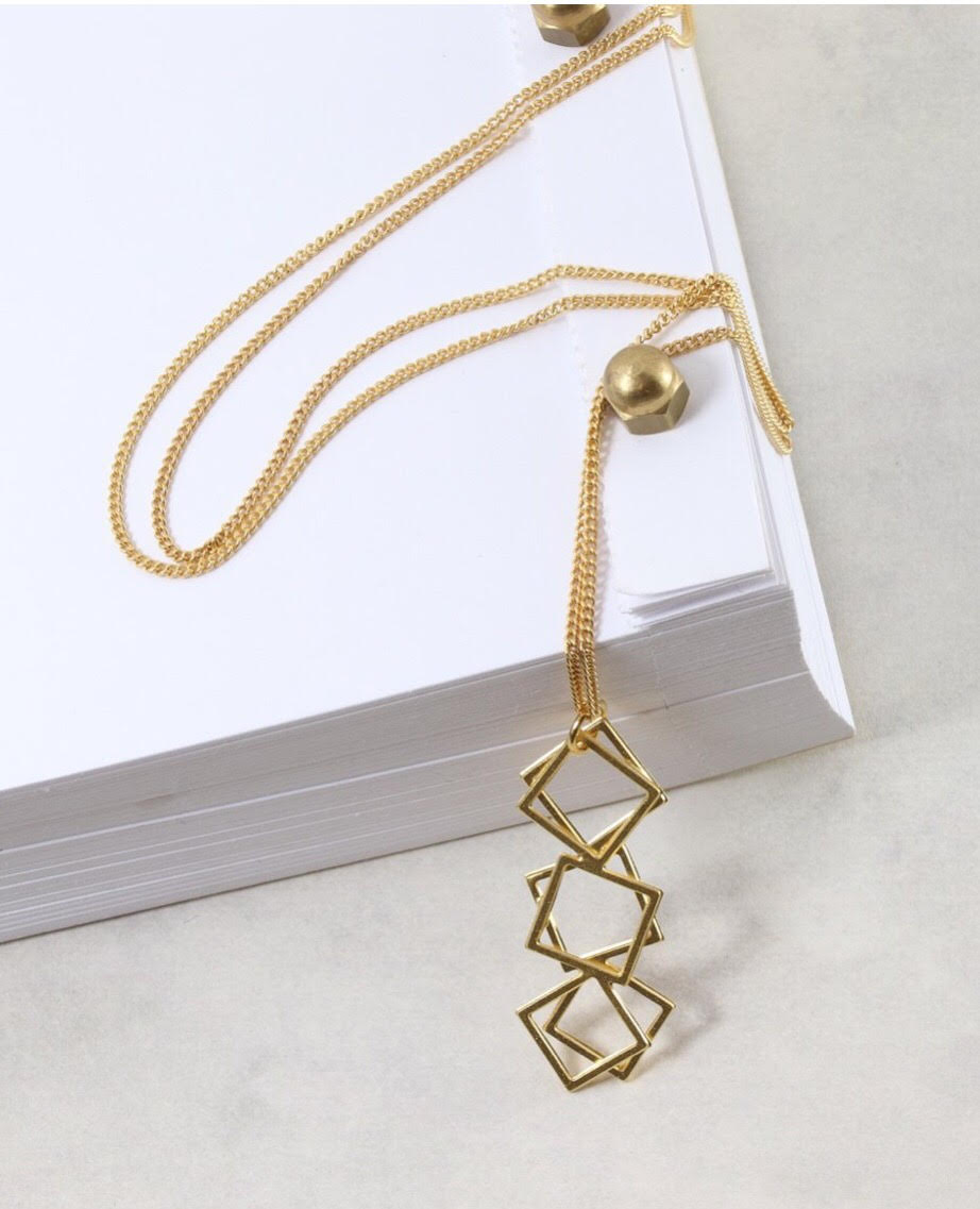 We love the layered geometric design on this pendant necklace.