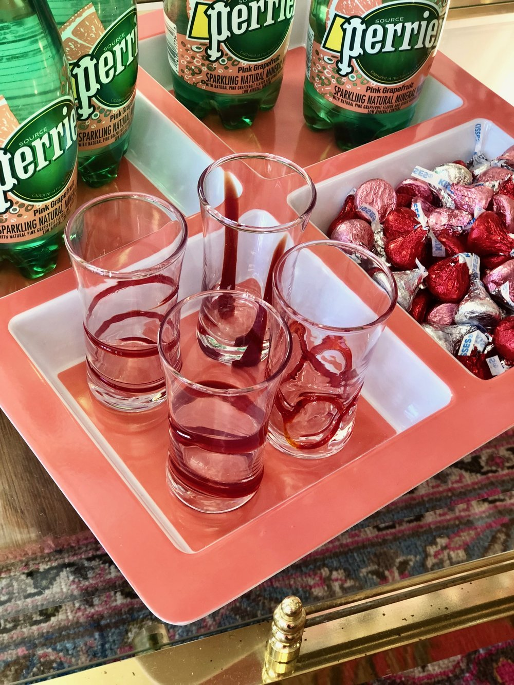 Shot glasses with a brushstroke of red continue the theme and can be used for many more celebrations with the same hue—Christmas, Fourth of July, Memorial Day, and more.