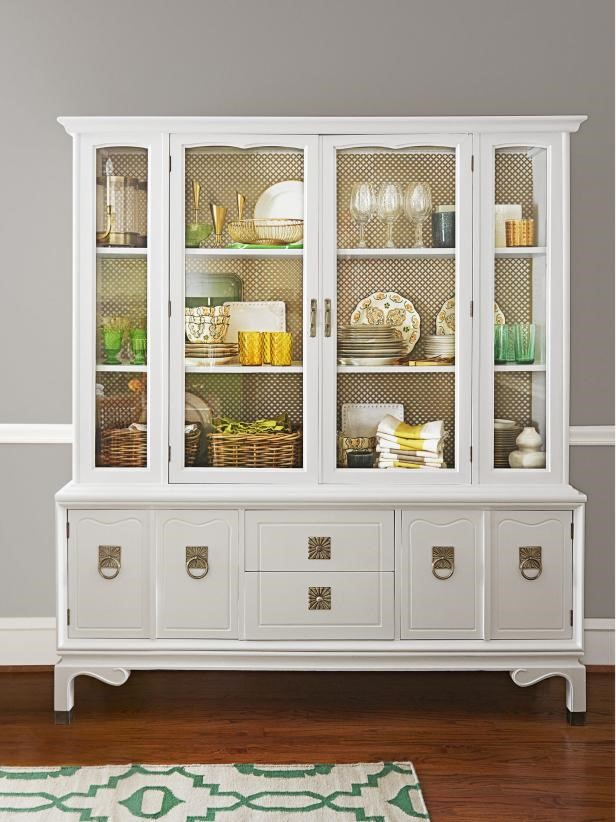 Photo Source:  HGTV   This china cabinet is used to store several entertaining accessories and the simple patterned backdrop provides an accent without being too busy.