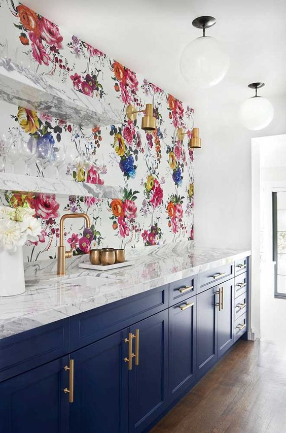 Photo Source:  Domino   The clear glassware on the shelves allows the bright floral paper in this kitchen to be truly captivating.