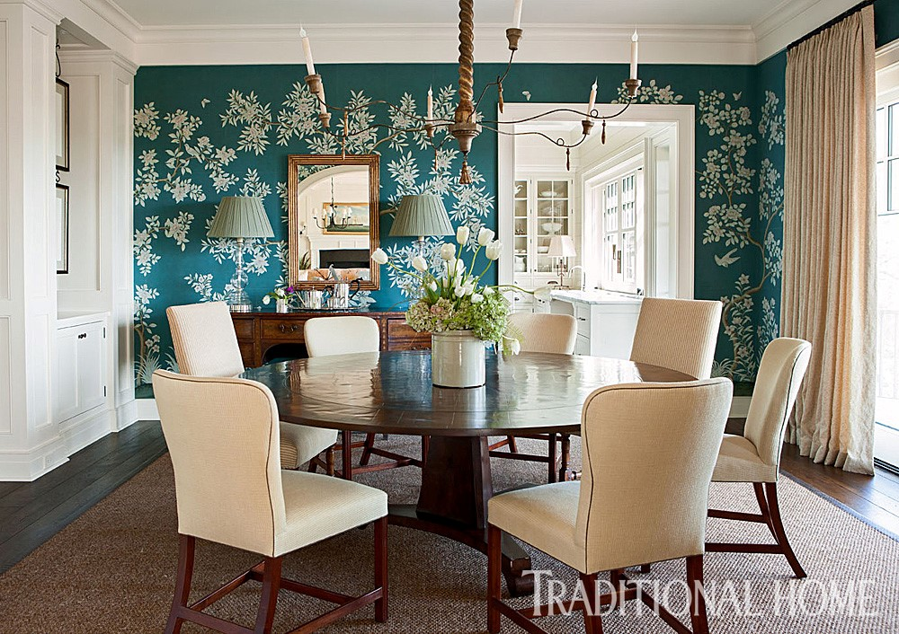 Photo Source:  Traditional Home   The floor to ceiling covering creates an exquisite place to enjoy a meal.