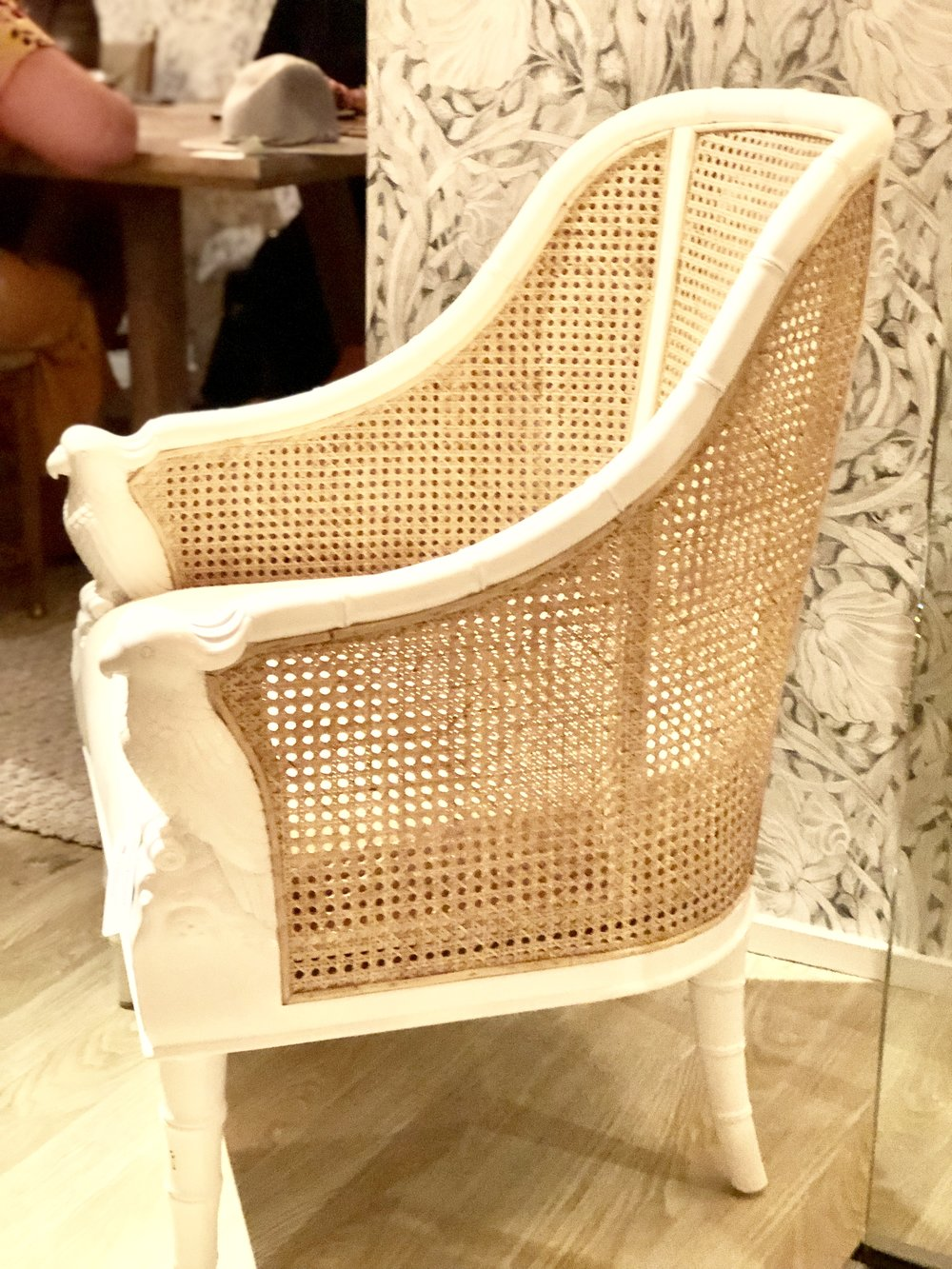 Here, the natural caning is paired with a glossy, white chair frame.