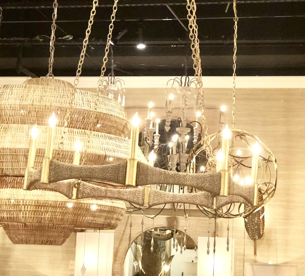 See how the natural rope is wrapped around the brass frame of this chandelier.