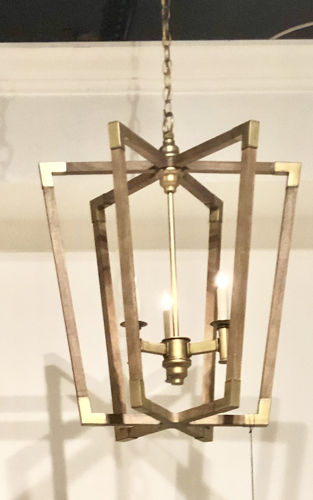 The light, washed wood capped with brass ends.