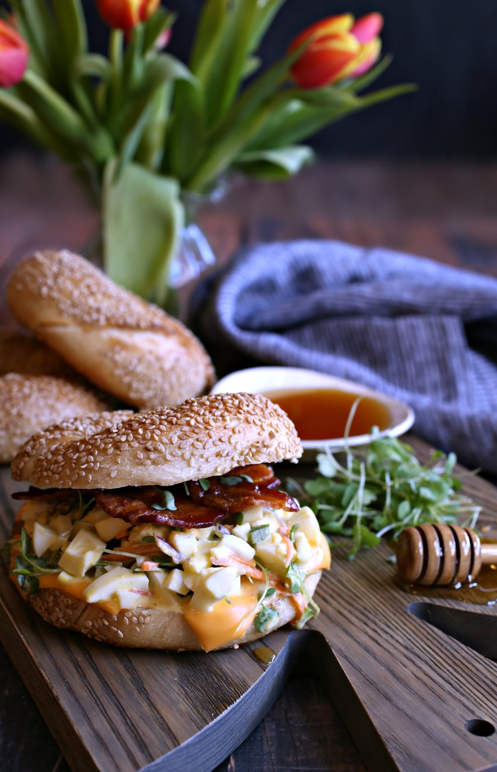 Loaded Egg Salad Bagel with Honey Roasted Bacon Vertical.jpg