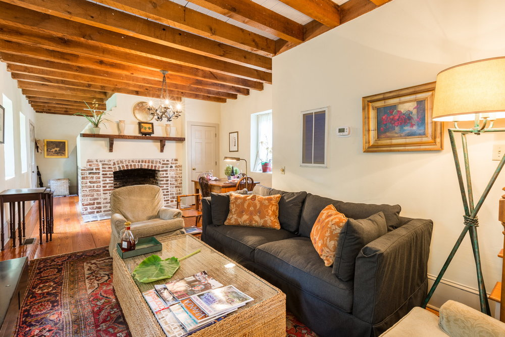 - The Living area downstairs is comfortably and elegantly furnished to relax after your day walking around historic Charleston
