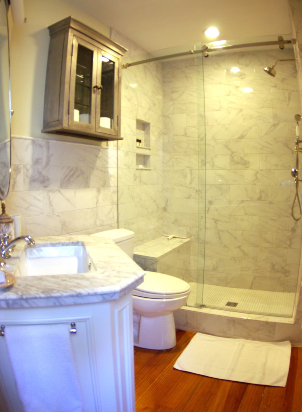 - Renovated full bathroom features beautiful marble and premium quality towels.