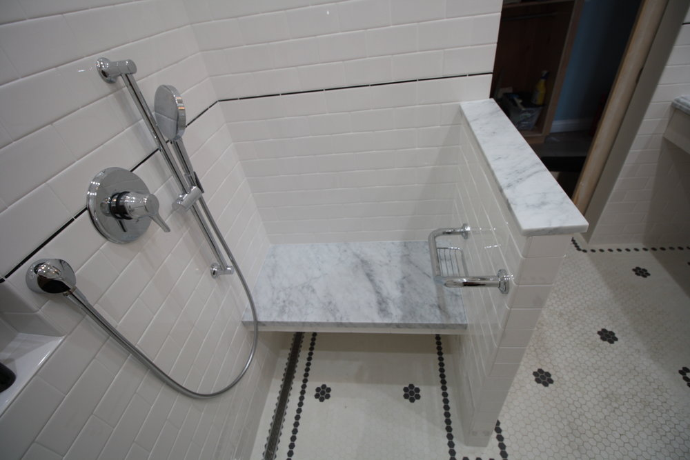 A New Line of Sight - Separate controls and heated bench seat & shower floor. Floor border & accent tile indicate locations of doors, walls and all controls for sight impaired owners. Floors, shower floor and bench are all heated for a comfortable showering experience.