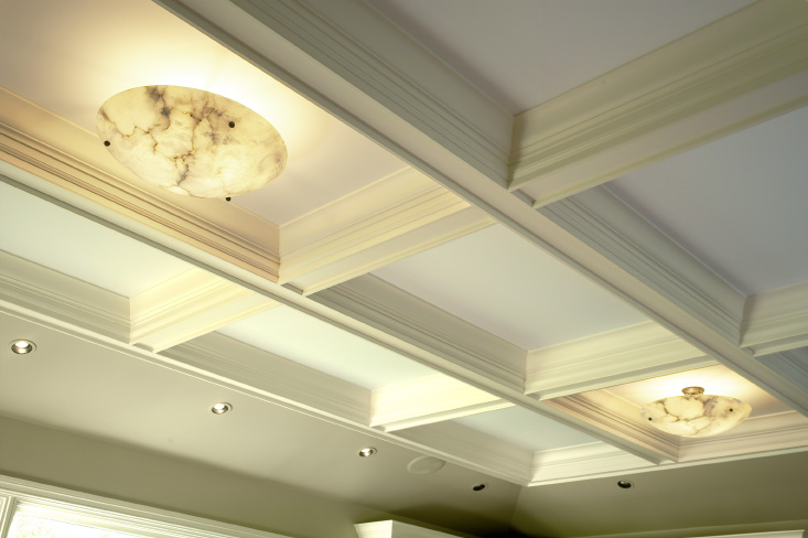 A Ceiling Not Forgotten - Because of existing roof framing challenges we designed a coffered ceiling that nested within the existing structure which maximized ceiling height and minimized the framing issues.