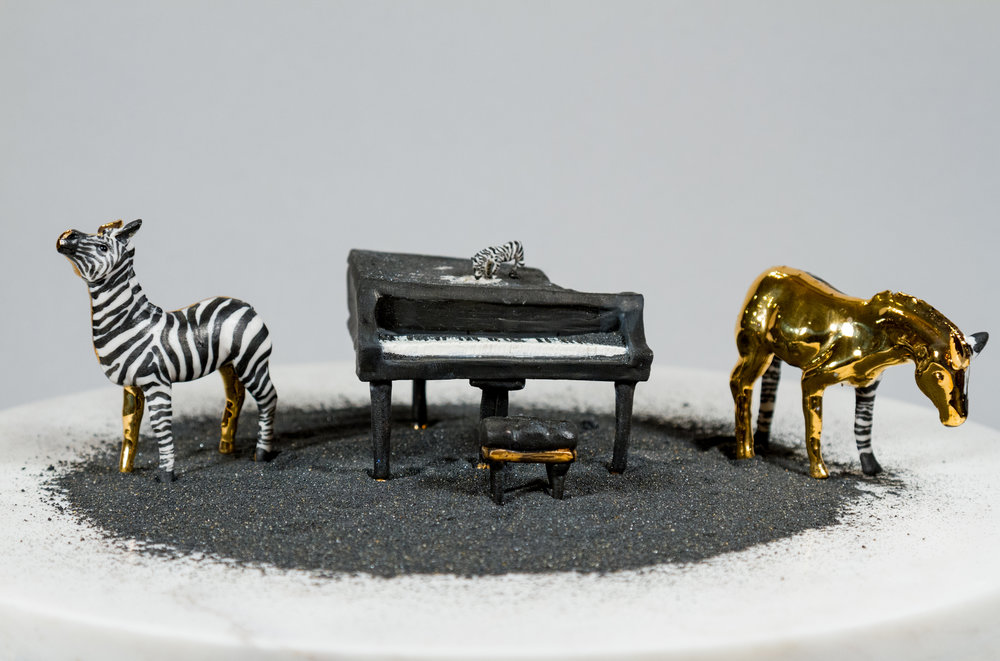""" How the Zebra Got Its Stripes""    Porcelain, Gold luster, Sand, Marble, 12"" x 12"" x 7"""
