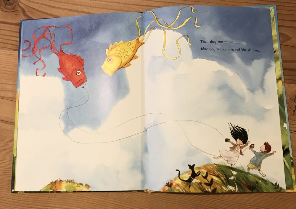 Jonathan Bentley's illustration for  Blue Kite, Yellow Kite  by Janet A Holmes (Little Hare). The clouds add extra frisson to this wild windy day.