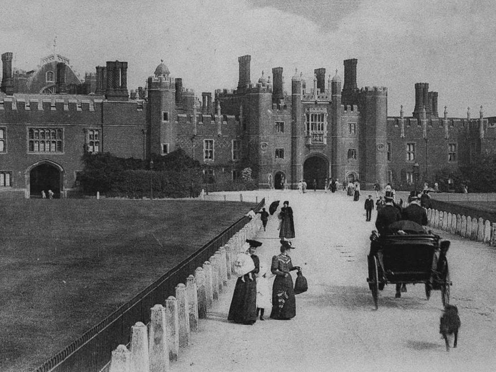 Hampton Court Palace with dog chasing carriage
