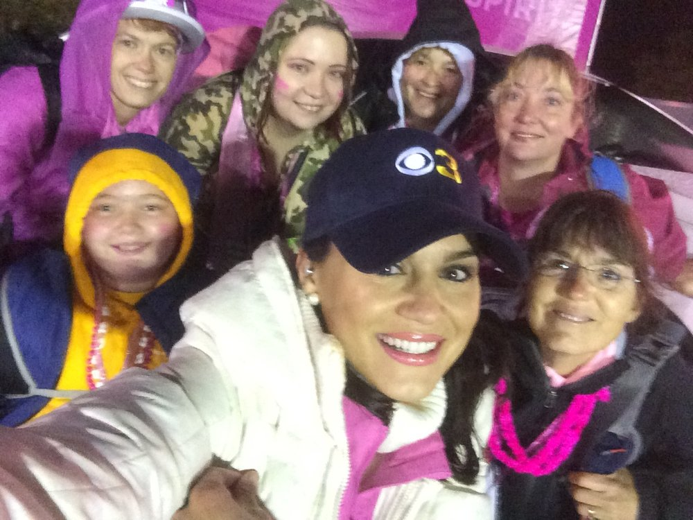 Nicole Brewer with walkers ahead of a breast cancer event.