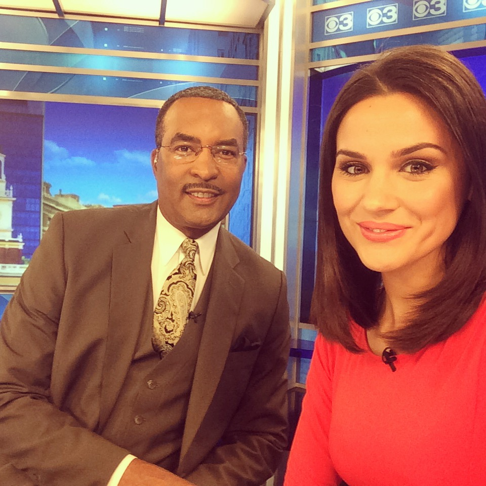 Nicole Brewer poses alongside co-anchor and friend Ukee Washington