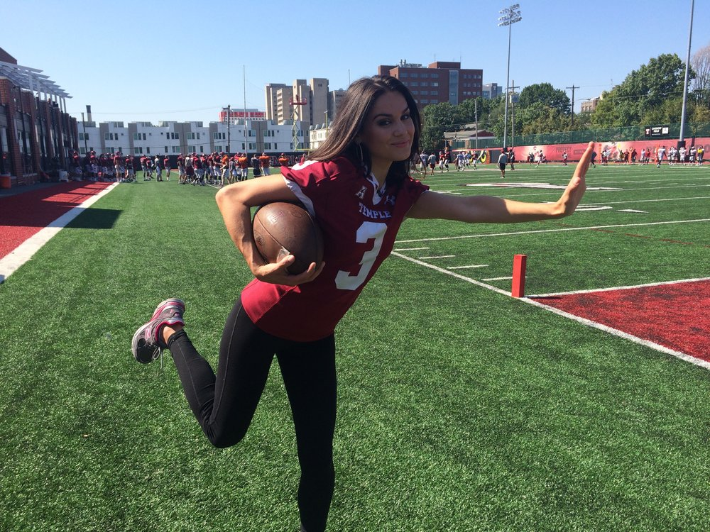 Nicole Brewer strikes her best Heisman pose, in honor of Temple's football team!