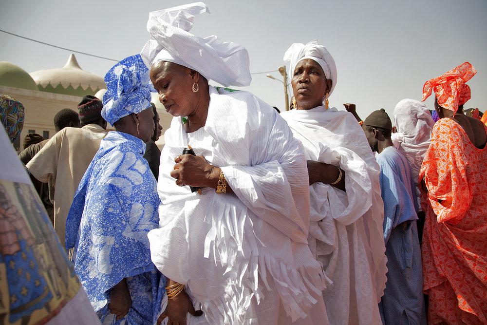 """Women Paying Respect to Mame Diarra Bousso, Prokhane""  — Image by Laylah Amatullah Barrayn, Senegal, 2014"