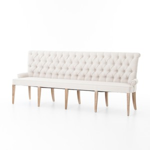 Banquette Bench - Traditionally present, this banquette combines deep hand-tufting of the Light Sand fabric with soft curves and splayed whitewashed legs, keeping it contemporary in a variety of different settings.$1469