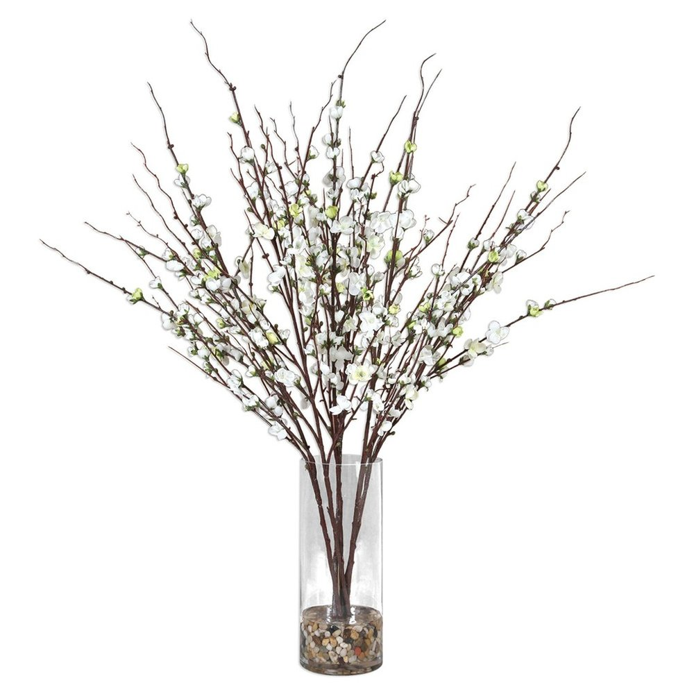 Quince Blossoms Silk Centerpiece - Effortlessly Arranged As If Freshly Harvested, These Quince Branches Exemplify The True Characteristics Of Live Blooms. Varying In Stages Of Openness, Cream Buds Are Accented By Natural Rocks In A Clear Glass Vase.$309