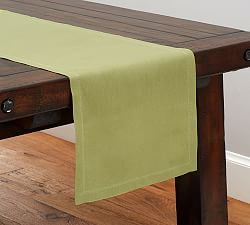Add a pretty solid color - This will set a colorful foundation for the decor to be added to the center of the table.