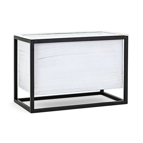 The perfect planter - I chose this one for this table because if its simple clean lines and modern flare. The black and white works perfectly with our foundation pieces too.