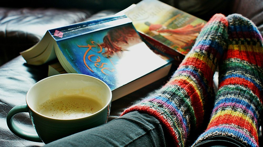 Woman reading as self-care for Christian moms