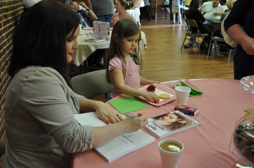 Christian fiction author and motivational speaker Emily Paige Skeen signing books