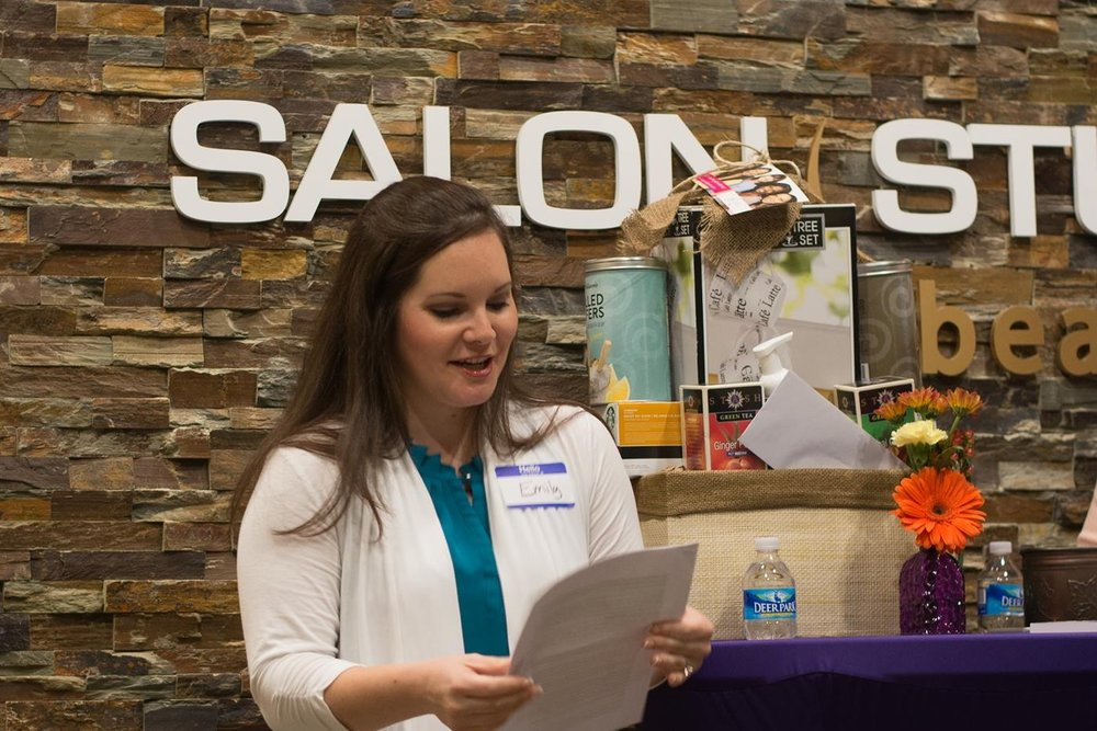 Author and speaker Emily Paige Skeen giving a speech at a Girl's Night Out event