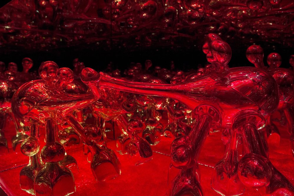 Cheerfully Rooting Through Ruby Red Detritus