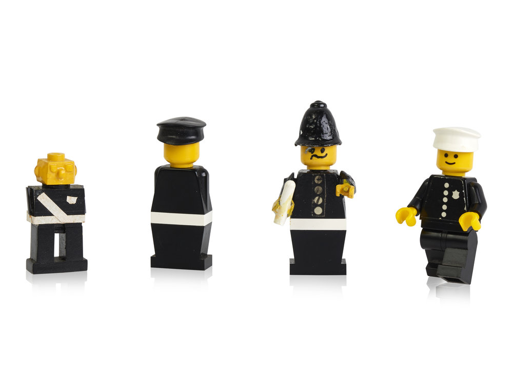 Early prototypes and first police minifigure.jpg