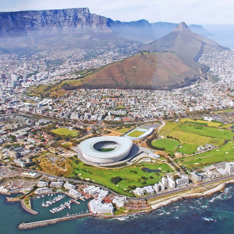 Unknown (2017) Cape Town Aerial View. Available at:https://www.citysightseeing.co.za/cape-town/news/entry/explore-the-mother-citys-top-attractions-and-save-with-the-cape-town-city-p - Within the capitalist milieu that has come to define the 21st century, what agency do young designers have, if any, to affect change towards greater urban social justice? In an era of globalization and multi-national corporations, national and city governments have abandoned their mandate of placing the needs of citizens as a top priority. The race to become a desirable investment destination for global capital has had a profound impact on how our cities prioritize their development. Nowhere is this disturbing phenomenon more pronounced than in the Global South, where colonialism and oppressive regimes have already negatively affected urban environments.Within such a context, what role can young design professionals play in challenging the status quo? One important emerging arena would be the design competition, which not only gives a platform that would otherwise be unavailable to young designers, but also acts as a laboratory to test out ideas and solutions to issues that affect our urban environment. Competitions pose unique opportunities for grassroots activism by communities in collaboration with designers to challenge powerful groups and organizations.An example of this was the Tafelberg Challenge in Cape Town, South Africa. The competition was an open call to architects, urban designers and planners to submit alternative proposals to the sale of well-located state-owned land by the provincial government to the private sector to generate revenue for affordable housing on the periphery of the city. Cape Town, current water crisis notwithstanding, has been experiencing a property boom, with some of the highest property price increases in the world. The city and provincial government has seen this trend as an opportunity to sell off valuable, under-utilized state land to developers 